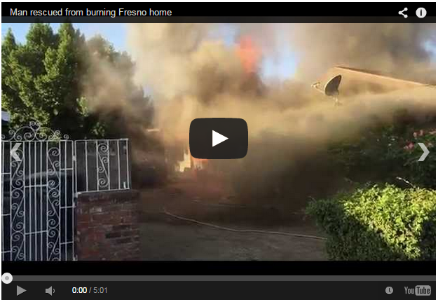 Watch this hero run into a burning house to save someone